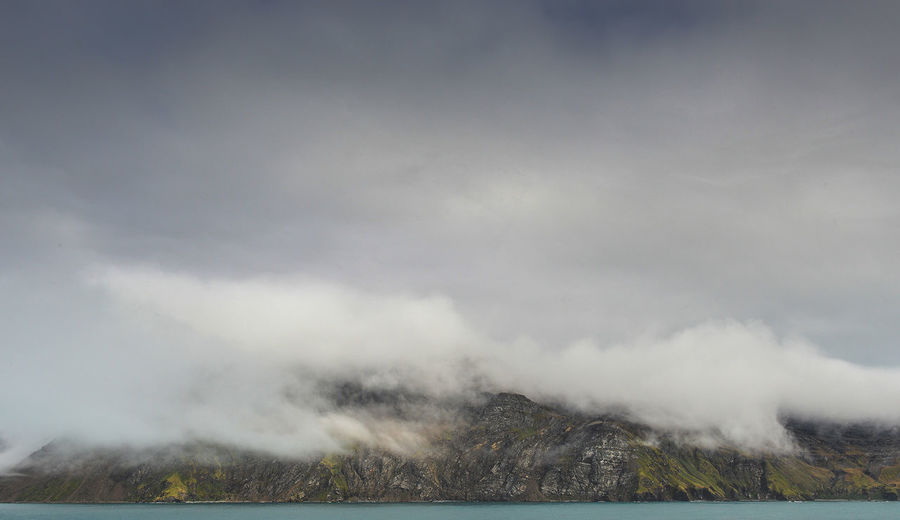 Low cloud envelopes the cliff face whilst approaching the old whaling village of Grytviken, South Georgia. Beauty In Nature Cliff Grytviken Keith Morgan Nature Rolling Clouds Scenics South Georgia Tranquility Water