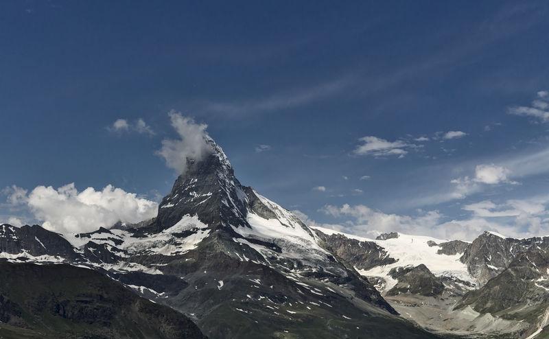 The Matterhorn - picture taken July 2018 Hicking Matterhorn  Alps Beauty In Nature Cold Temperature Landscape Mountain Mountain Peak Mountain Range Nature Outdoors Sky Snow Summer Switzerland