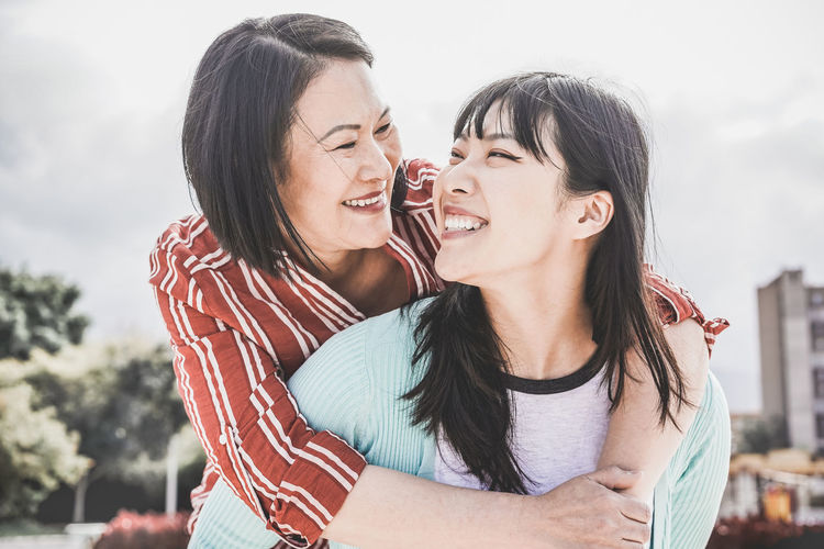Asian mother and daughter having fun togheter Asian  ASIA Japan China Togetherness Two People Love Emotion Women Happiness Bonding Lifestyles Leisure Activity Smiling Hair Mother Family Daughter