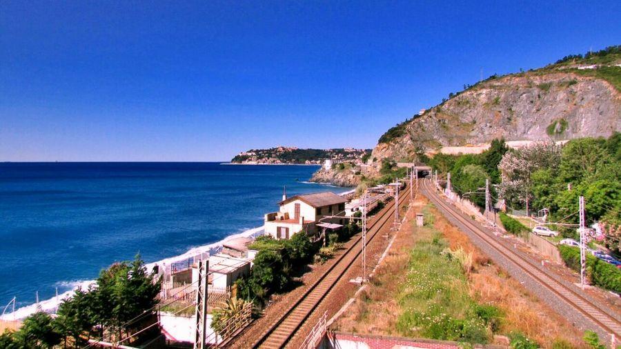 High angle view of railway tracks along calm blue sea