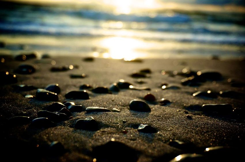 Beach Beach Life Beachphotography Beauty In Nature Close-up Focus On Foreground Idyllic Nature No People Non-urban Scene Outdoors Sand Scenics Seaside Selective Focus Shore Sky Stone - Object Sun Sunbeam Sunlight Sunset Surface Level Tranquil Scene Tranquility