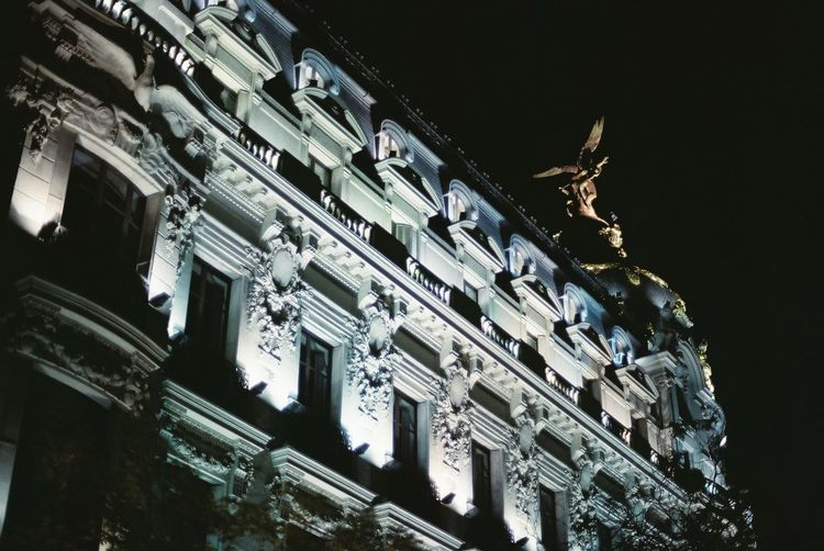 Analogue picture taken with a Canon AE-1 at night in Madrid. No flash. Analogue Photography Madrid Architecture Building Building Exterior City Low Angle View Night Outdoors Sculpture Statue Travel Destinations