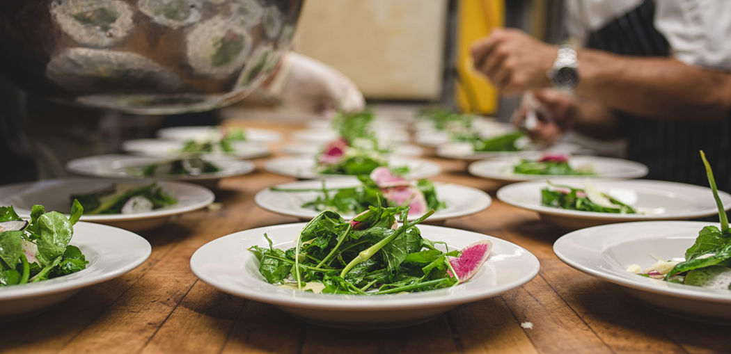 Close-Up Of Salad In Plates On Table