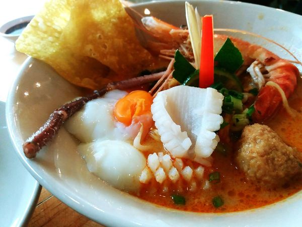 Hot and spicy seafood noodle in white bowl, Tomyum noodle. Ready-to-eat Plate Food And Drink Meal Freshness Close-up Serving Size Healthy Eating Noodles Seafoods Spicy Food Tomyum Noodle Tasty Delicious Lunch Still Life Photography Onsen Egg Shrimps Octopus Boiled Egg White Bowl Soup