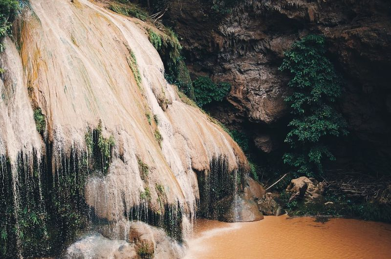 Brown waterfall Scenics Rock - Object Waterfall Beauty In Nature Geology Tranquility Rock Formation Tranquil Scene Non-urban Scene Nature Tourism Idyllic Flowing Physical Geography Cliff Eroded Natural Landmark Flowing Water Water