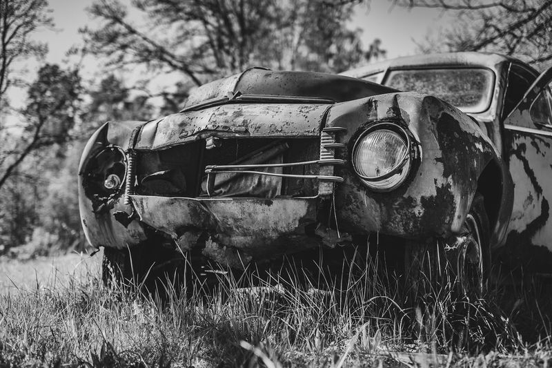 Front of an abandoned volvo pv 444. a swedish car manufactured during 1944-1957