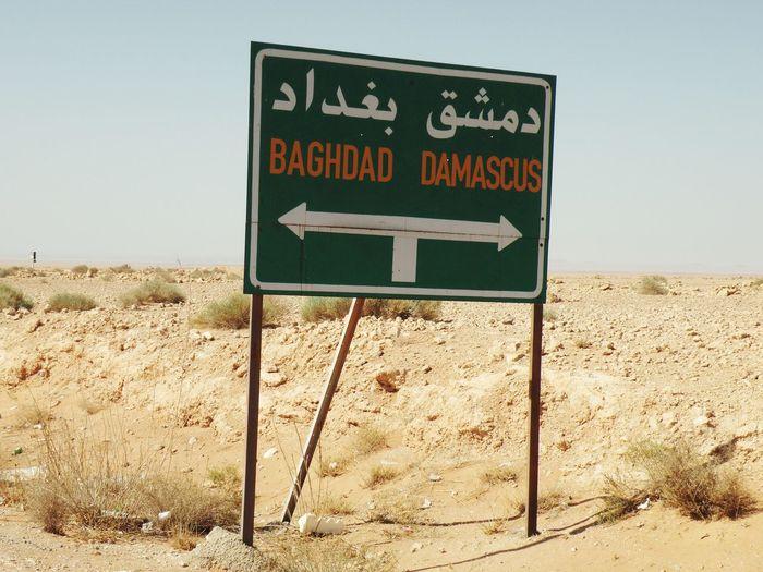 Road Sign On Arid Landscape