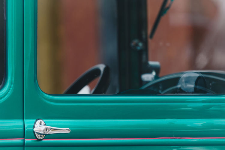 Close-up of vintage turquoise car