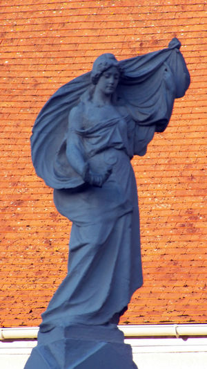 Woman statue who s looking down French Statue Woman Sculpture Woman S Appearance Blue Statue Day Female Likeness Human Representation Look Down Statue White Statue Full Lenght 16x9 Vertical Photography In France
