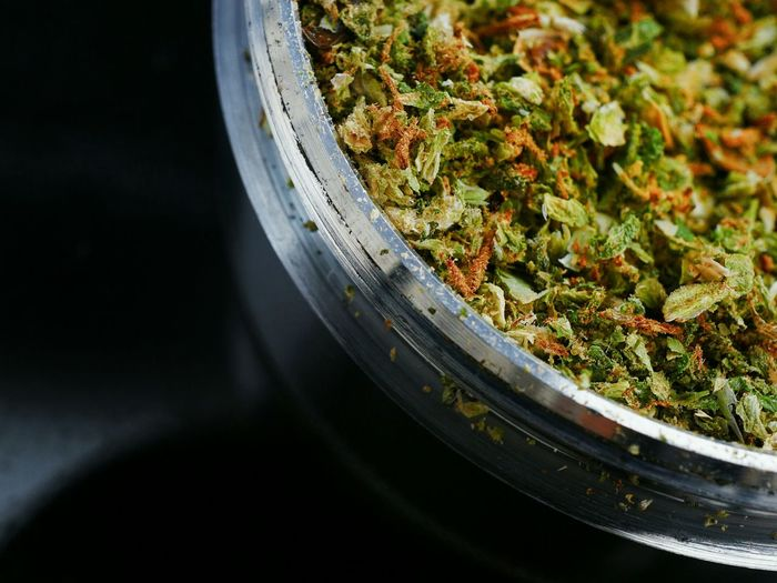 Close-Up Of Marijuana On Table