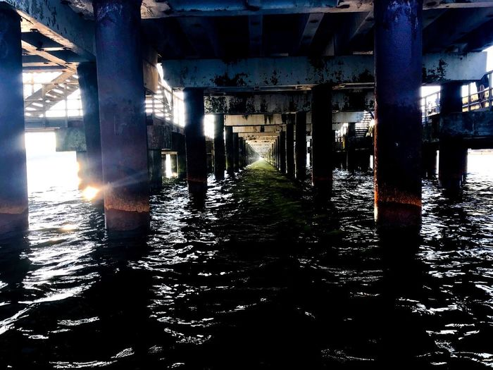 Early morning under the bridge Architecture Built Structure Indoors  Architectural Column Building No People Reflection Day Water Arcade Sunlight Nature