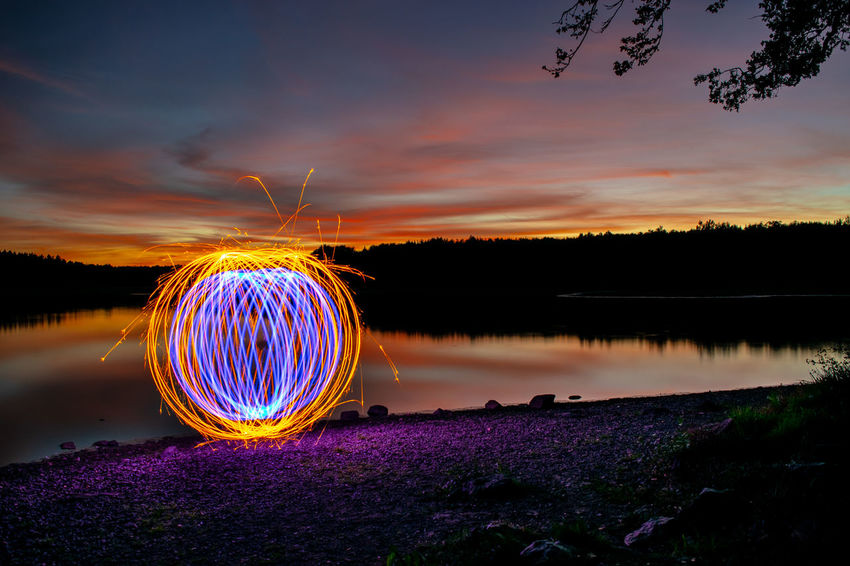 Sunset & ORB Orb Beauty In Nature Blurred Motion Cloud - Sky Glowing Illuminated Lake Long Exposure Motion Night No People Orange Color Reflection Sky Sparks Steelwoolphotography Sunset Water Wire Wool