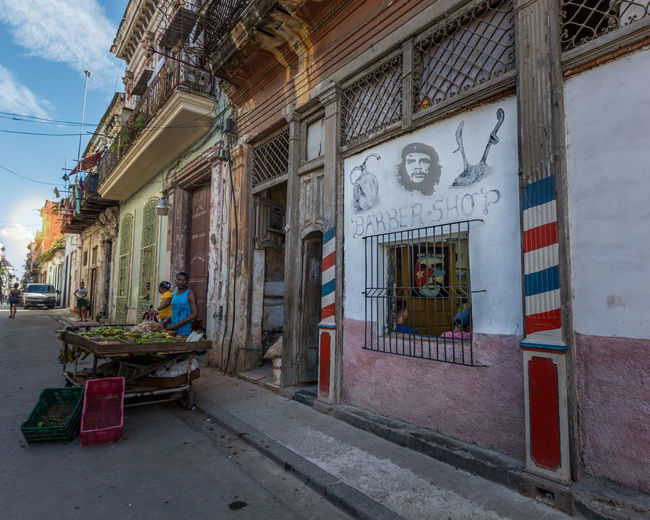 Street photo of Havana, selling fruits in Habana. Che Guevara Mural Cuba Architecture Building Building Exterior Built Structure Business Che Guevara City Day El Che Entrance Food Food And Drink Havana Cuba Nature No People Outdoors Residential District Retail  Sky Small Business Street Transportation