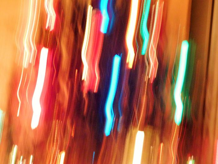 Lights on a Christmas tree, blurred by fast motion. The holidays go by so fast- too fast sometimes- in a blur of motion like this- the rushing to stores to buy presents, the visiting relatives and friends, the parties, the decorating, the cookie baking, the countdown to get everything done. It al feels surreal and like a blur when it is all over! (Picture taken at my home in Largo, Florida) Abstract Abstract Photography Abstractions In Colors Blurred Motion Christmas Christmas Lights Christmas Tree Lights Colorful Festive Festive Lights Full Frame Illuminated Life In Motion Lights On Tree Multi Colored Pattern Symbolic  The Culture Of The Holidays Vivid Colors Wavy Lines