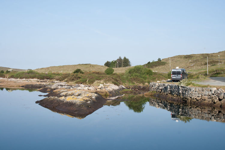 Caravanning National Park Beauty In Nature Blue Caravan Caravan Holiday Clear Sky Conemara Day Lake Mobile Home Motor Home Motor Vehicle Nature No People Outdoors Reflection Rocks Rough Sky Transportation Water Waterfront
