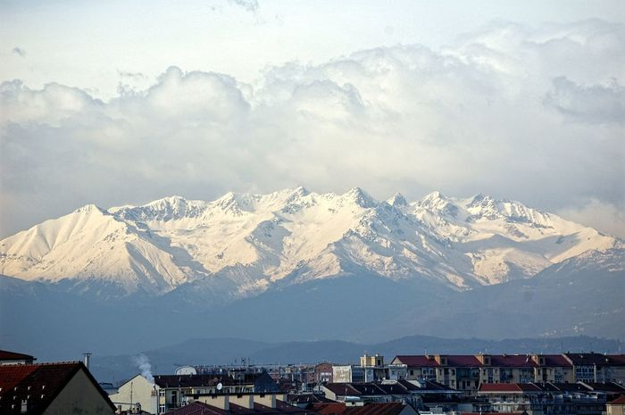 At the foot of the Alps Turin From The Balcony My City Beauty In Nature Mountian View Clouds And Sky Shades Of Winter Mountain Snow Mountain Range Winter Snowcapped Mountain No People Landscape Cold Temperature Outdoors Sky #urbanana: The Urban Playground