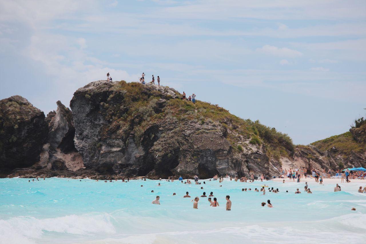People Swimming In Pool Against Sky
