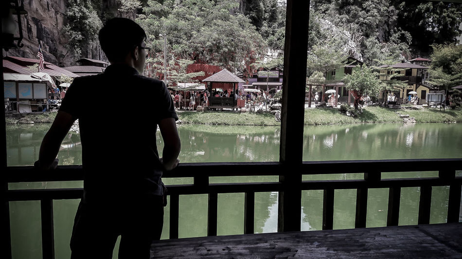 Lake Backside Portrait Lake View Low Saturation One Person Outdoors Teenager Wooden House