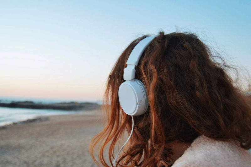 Song On The Beach Adult Adults Only Beach Clear Sky Close-up Day Freedom Headshot Horizon Horizon Over Water Human Body Part Nature One Person One Woman Only One Young Woman Only Only Women Outdoors People Rear View Sea Sky Women Young Adult International Women's Day 2019