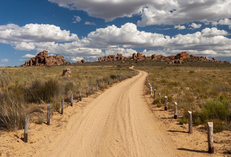 Panoramic shot of dirt road against sky