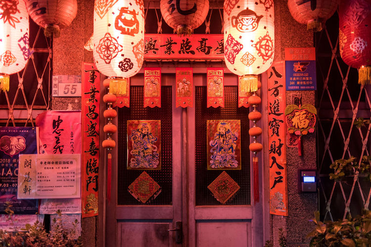 Illuminated lanterns hanging in traditional building
