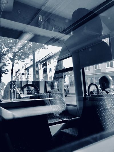 View of bus on car window