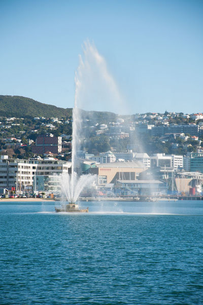 Water fountain in Wellington Harbour Fountain Wellington Harbour City Cityscape Motion Spraying Water Water Fountain Waterfront