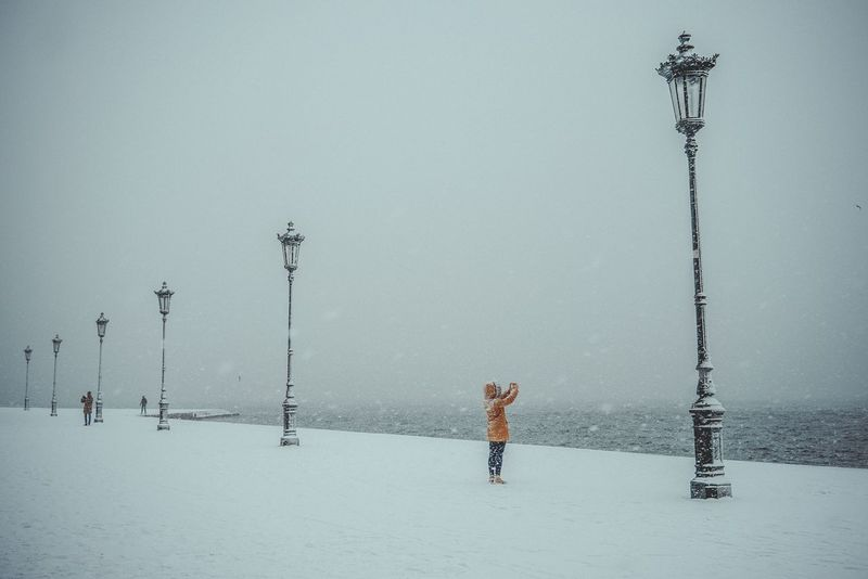Winter Cold Temperature Snow Weather Real People Full Length One Person Lifestyles Street Light Leisure Activity Snow ❄ Snowing Woman Wether Outdoors Clear Sky Beauty In Nature Sky Day Scenics Warm Clothing Thessaloniki Greece Europe Cold Days