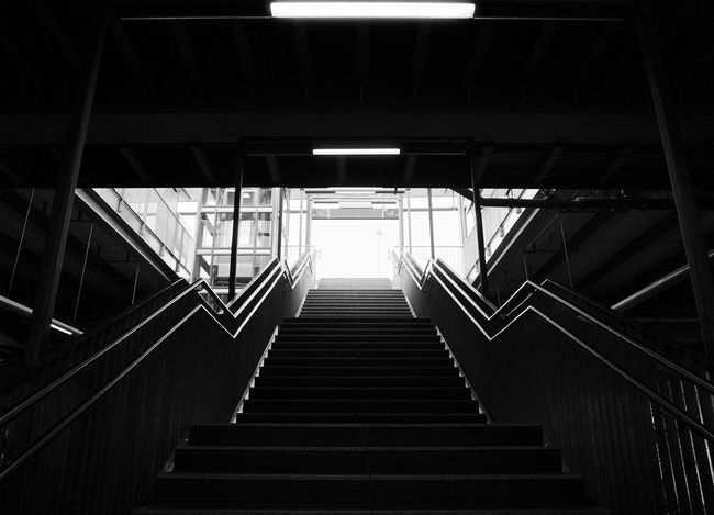 Into The Light 35mm Film Nikon FA Backlight Analogue Photography Blackandwhite Schwarzweiß Black And White Monochrome Hand Rail Illuminated Low Angle View No People Railing Railway Station Staircase Steps Steps And Staircases The Way Forward Black And White Friday