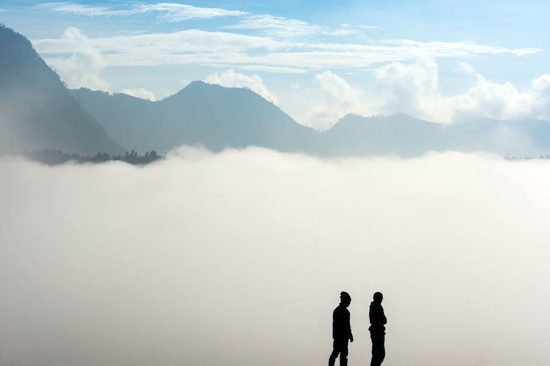 The Great Outdoors - 2016 EyeEm Awards Silhouette of Two Men Standing with Foggy Mountain Background at Mount Bromo , Bromo Tengger Semeru National Park East Java INDONESIA The Following Two Is Better Than One