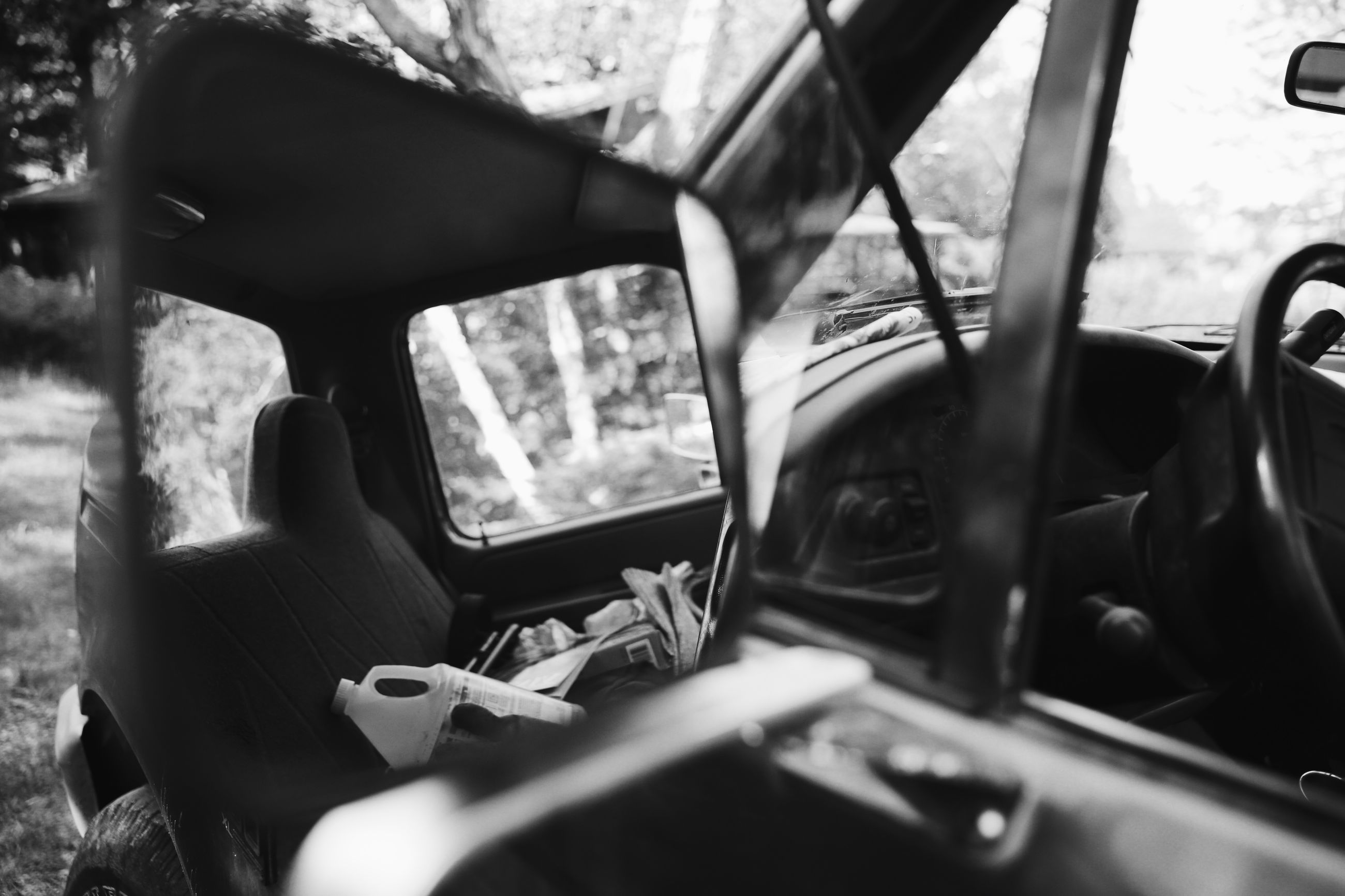 lifestyles, leisure activity, sitting, transportation, mode of transport, men, young adult, vehicle interior, land vehicle, car, photographing, photography themes, holding, person, travel, casual clothing
