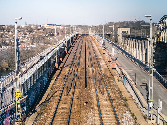 High angle view of railroad tracks in city against sky