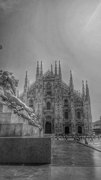 In Milan. Architecture Built Structure Travel Destinations Sculpture Building Exterior City Outdoors Cityscape Cathedral DuomoDiMilano Black And White Grey Urban Gothic Architecture Church Square Art History History Sightseeing Milan Italy