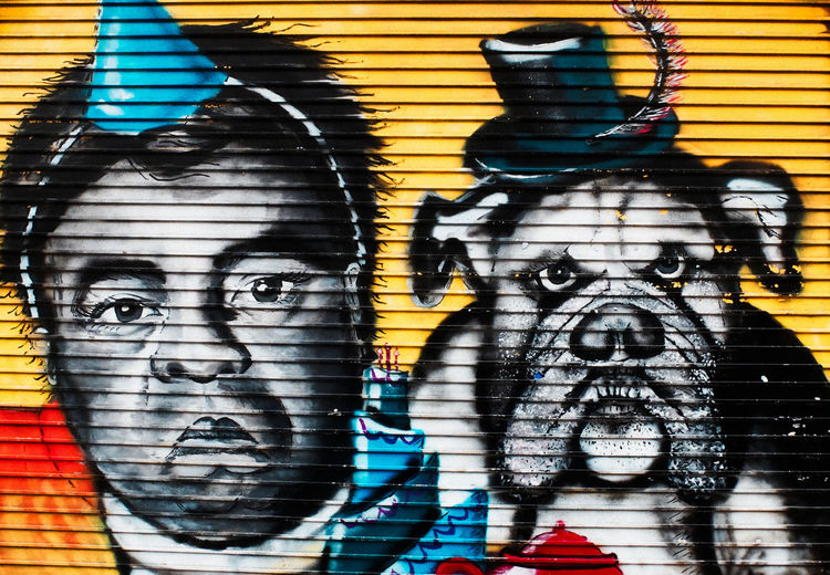 Dog Faced Boy, Graffitti Brixton Architecture Art Art And Craft Brick Wall Building Exterior Built Structure Clothing Colours Creativity Day Documentary Nature Photography Photography Taking Photos A Dog Face Boy Graffiti Human Representation Indoors  Multi Colored Mural Painting Reportage Street Photos Taking Fotos Images Photographic Camera Lens Architectural Design Building Structual Support Detail Of Tower Block In Sunshine Blue Sk Shadow Street Art Street Photography Wall Wall - Building Feature