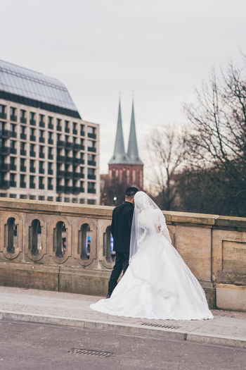 Built Structure Architecture Building Exterior Religion Wedding Belief Bride Newlywed Wedding Dress Celebration Event Place Of Worship Life Events Spirituality Day White Color Building Outdoors Couple - Relationship