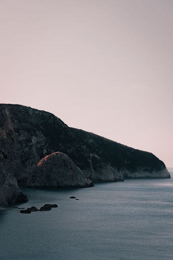 Nature Rock Formation Rocks Rocky Coastline Sunrise Sea Beach Clear Sky Mountain Sky Landscape Shore Rock Physical Geography Cliff
