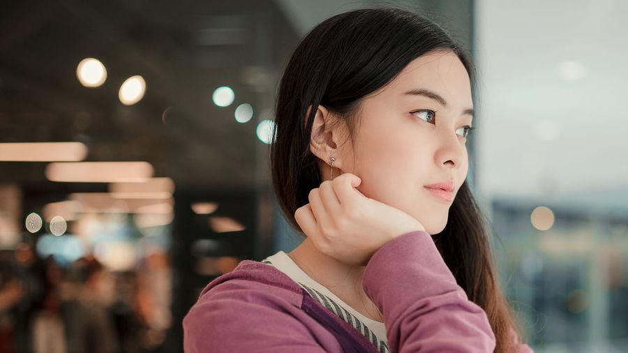 Portrait of a teenage girl looking away