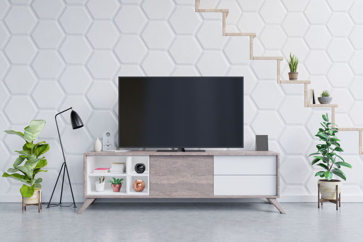 Smart TV on the cabinet in modern living room with plants on white hexagon tile background,3d rendering Plant Computer Table Technology Indoors  Flooring Nature Potted Plant Furniture No People Domestic Room Living Room Home Interior White Color Laptop Flowering Plant Modern Seat Flower Day Houseplant Tv Smart Tv Tv Room Shelf