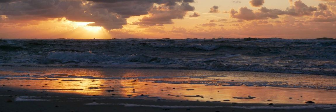 Sunset at the beach Banner Beach Beauty In Nature Cloud - Sky Germany Horizon Horizon Over Water Land Motion Nature No People Non-urban Scene Norderney Nordsee Orange Color Outdoors Power In Nature Scenics - Nature Sea Sky Sunset Tranquil Scene Tranquility Water Wave