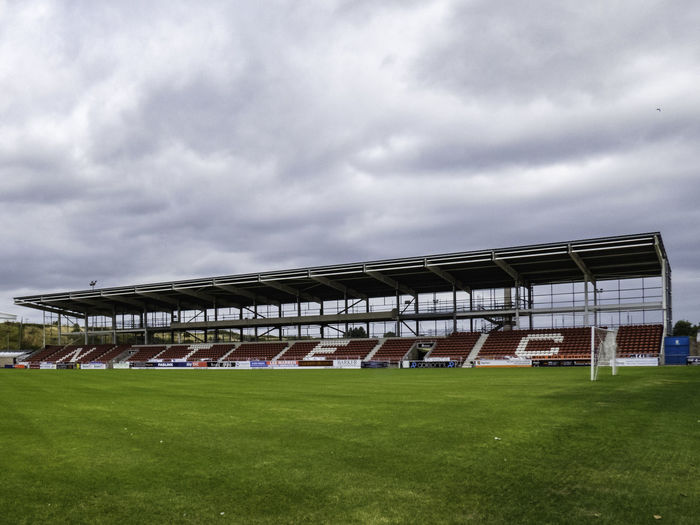 View of soccer field against cloudy sky
