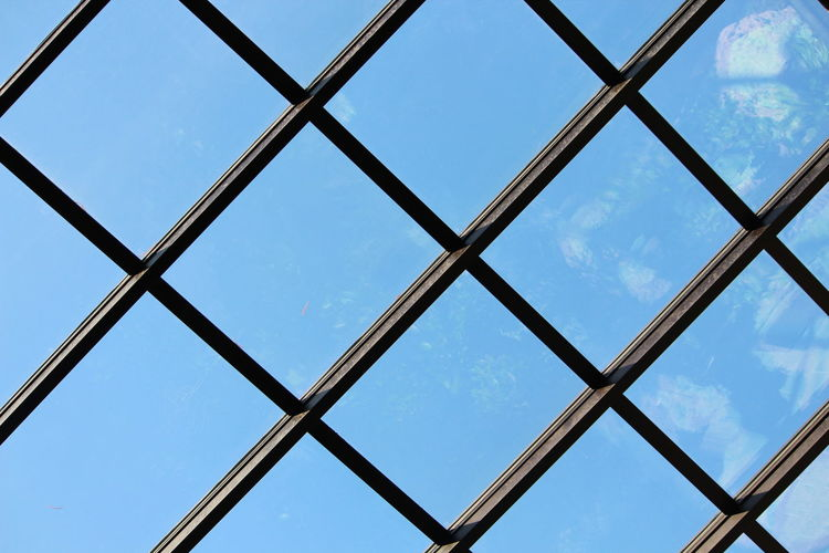 Sky Low Angle View Full Frame Pattern No People Backgrounds Window Day Built Structure Metal Nature Architecture Glass - Material Cloud - Sky Blue Sunlight Security Transparent Protection Outdoors Skylight Ceiling