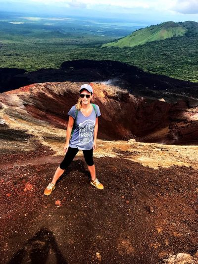 Front View Landscape Scenics Challenge Extreme Sports Adrenaline Junkie Nature Women Volcano Crater Hiking Trail Lava Rocks Lava Field Volcanic Crater Volcanic Rock Exploration Nicaragua Cerro Negro Hiking Volcano Landscape Volcano Determination Adventure Standing Power In Nature Looking At Camera
