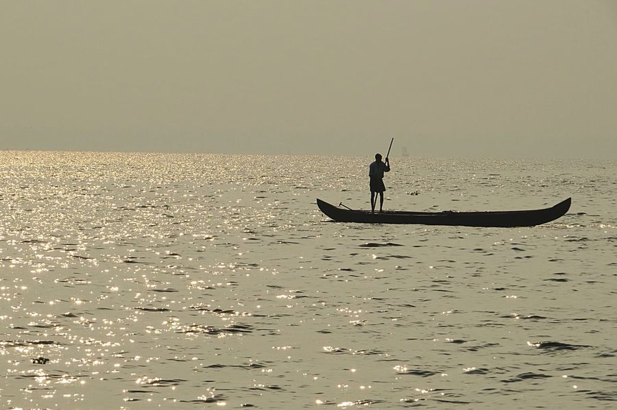 Sea Water Silhouette One Person Horizon Over Water Real People Nature Men Waterfront Scenics Outdoors Leisure Activity Day Adventure Oar Sunset Clear Sky Beauty In Nature Sky One Man Only Boat Kerala The Great Outdoors - 2017 EyeEm Awards The Photojournalist - 2017 EyeEm Awards Done That. Been There. Perspectives On Nature