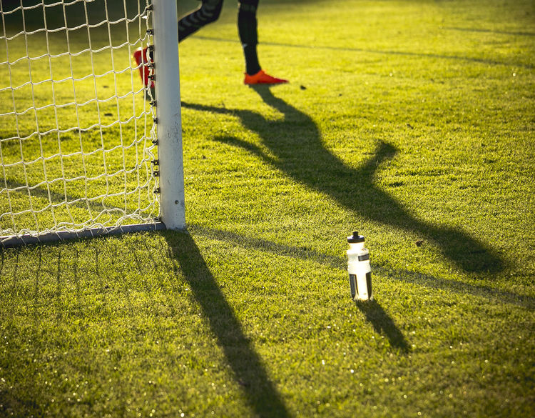 Adult Adults Only Day Grass Human Body Part Human Leg Leisure Activity Low Section Men One Man Only One Person Only Men Outdoors People Playing Refreshment Shadow Soccer Soccer Field Soccer Player Sport Sportsman Standing Sunlight