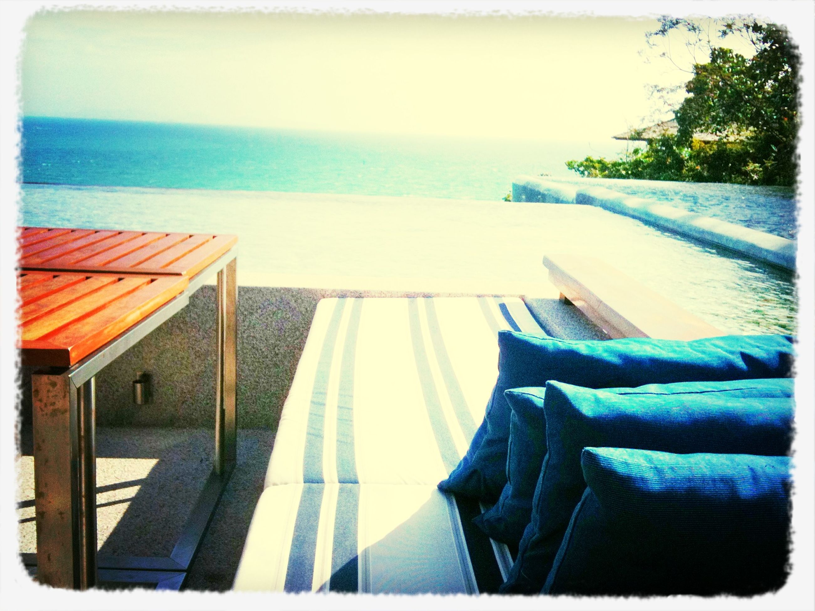 sea, transfer print, horizon over water, water, auto post production filter, railing, beach, absence, empty, chair, sky, sunlight, tranquility, day, lounge chair, nature, tranquil scene, table, swimming pool, relaxation