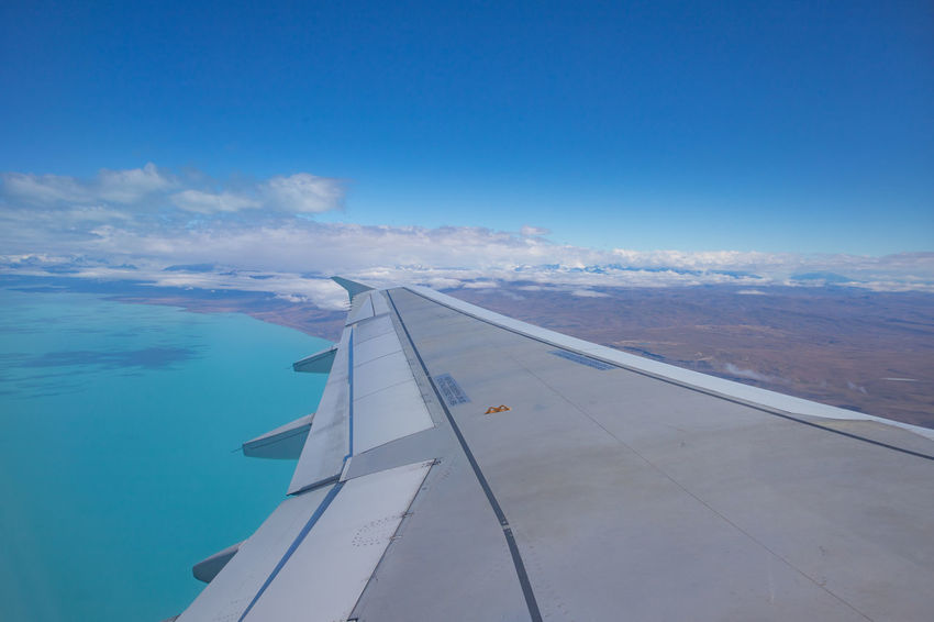 Cloudscape Above Aerial View Air Vehicle Aircraft Wing Airplane Argentina Beauty In Nature Blue Cloud - Sky Day Flying Lake Mode Of Transportation Motion Nature No People Outdoors Patagonia Patagonia Argentina Scenics - Nature Sky Transportation Travel View Into Land