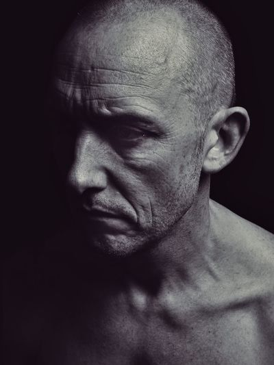 solipsism 01 Alone... Solitude Male Skinhead Skin Black And White Photography Black And White Life Age Chiaroscuro  Self Portrait One Person Headshot Portrait Indoors  Close-up Real People Emotion Mature Adult Studio Shot Adult Human Face Dark Shirtless Black Background
