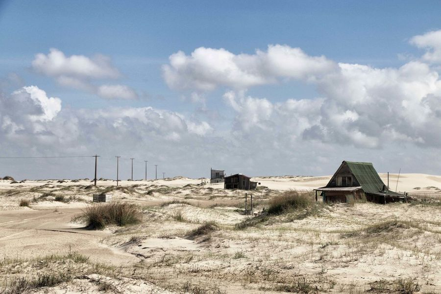 Cabo Polonio An Eye For Travel Cabo Polonio Desert Desert Life Fishing Village Wooden Houses Beauty In Nature Cloud - Sky Desert Beauty Desert Landscape Field Landscape Nature Outdoors Remote Place Sand Tranquil Scene Tranquility Uruguay