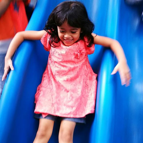 Portrait of happy girl on slide