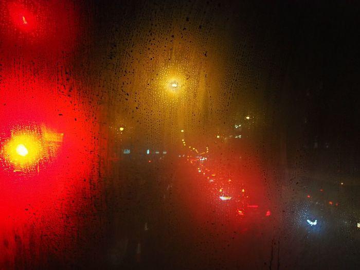 Wet glass window at night